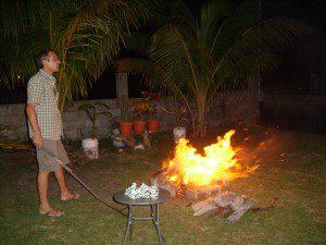 Dick tending the fire