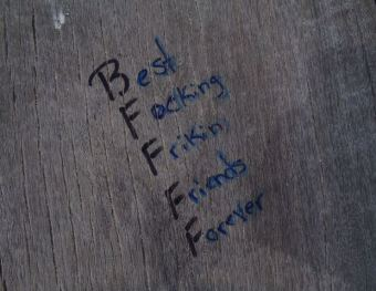 belize picture of graffiti on banyan bay beach resort dock