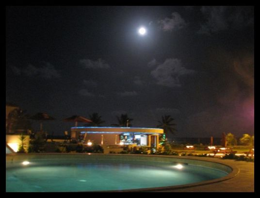 blue moon over  cowboy doug swim up pool bar at grand caribe belize