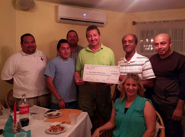 San Pedro Town Council donating a check to San Pedro Belize Red Cross