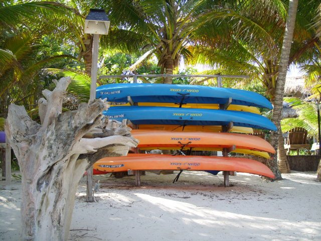 Kayaks on the beach in Belize by tacogirl blog