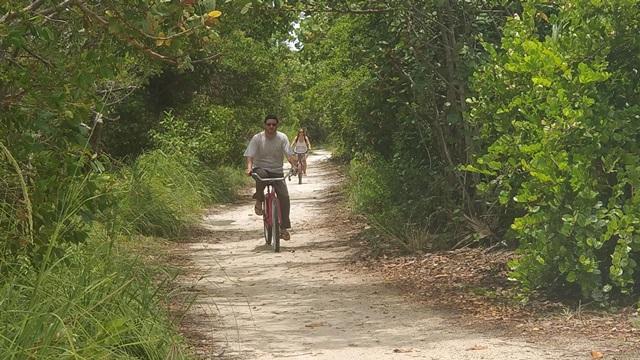 Riding bikes on sandy Caye Caulker roads