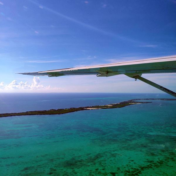 Flying from Ambergris Caye to Caye Caulker and Municipal Airport