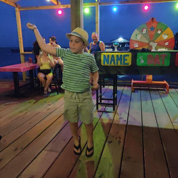 boy dancing at wayos ambergris caye