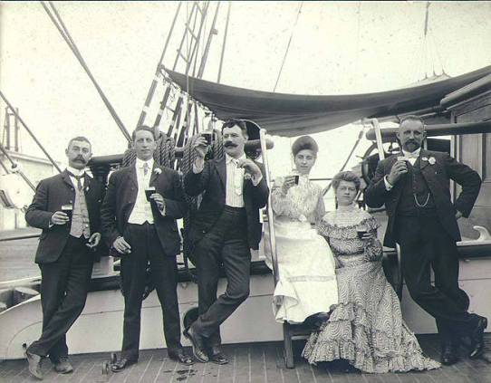 Four_men_and_two_women_on_the_deck_of_the_threemasted_bark_LAMORICIERE