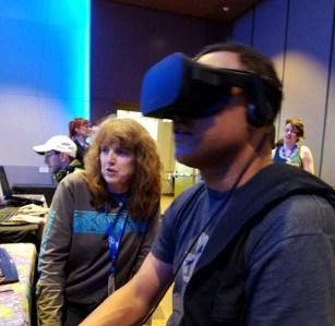 Kathy Flood demonstrating Infinite Scuba virtual reality