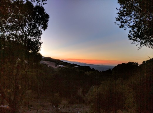 View from their porch of the sunset over Silicon Valley