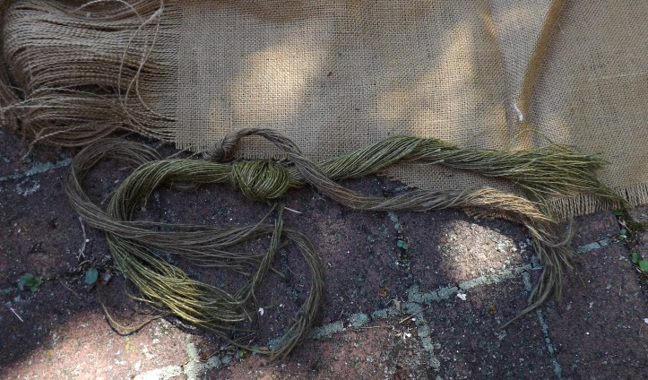 Dyed burlap for ghillie suit with natural burlap in the background.