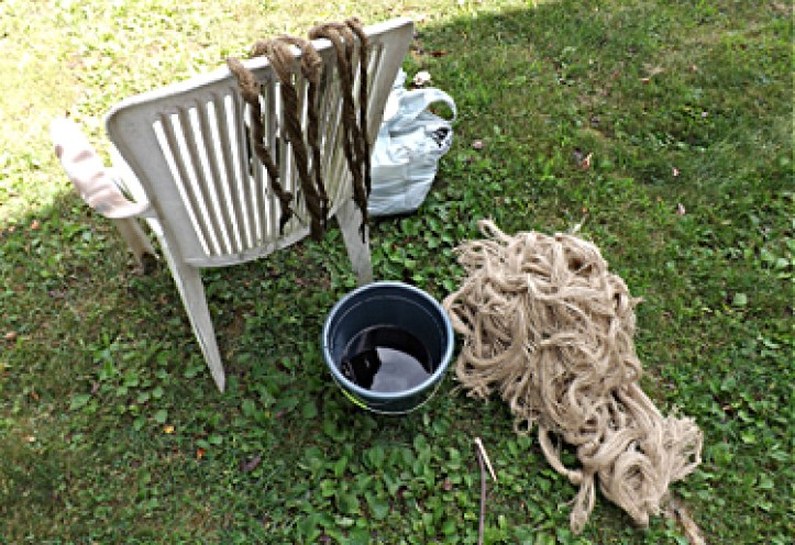 Make a ghillie suit - dying the burlap strings.