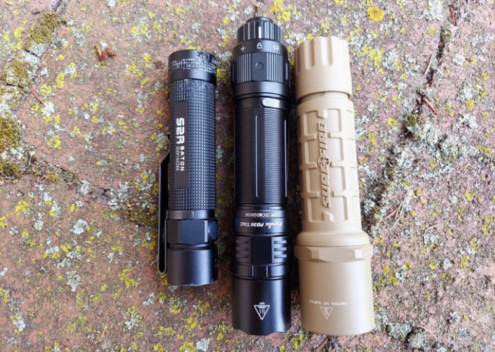 Olight S2R, Fenix PD36, and Surefire 6P Nylon tactical flashlights.