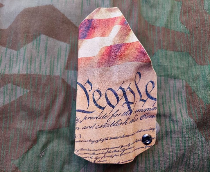 Springfield Hellcat holster from We the People with the US Constitution graphic.
