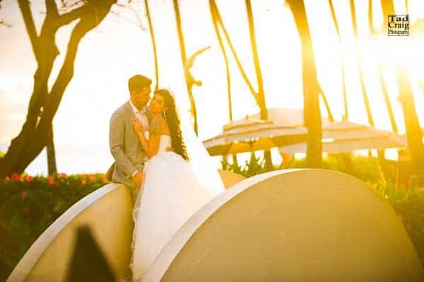 bride and groom holding each other at sunset at the bridge at the Hyatt Regency Maui Resort & Spa