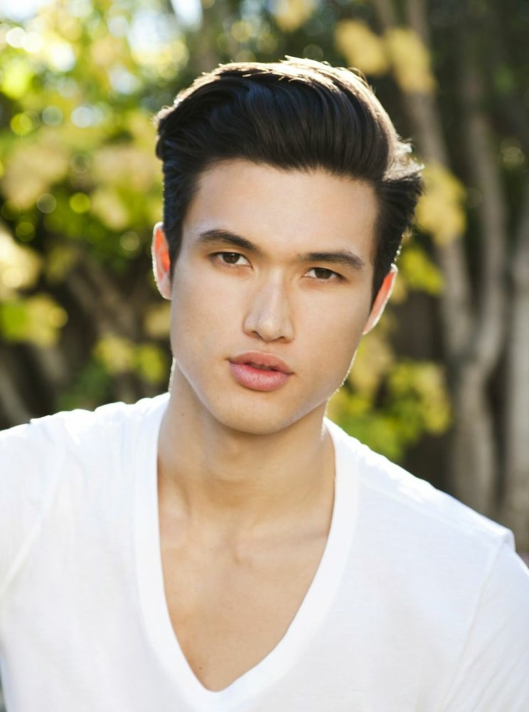 The 27-year old son of father (?) and mother(?), 185 cm tall Charles Melton in 2018 photo