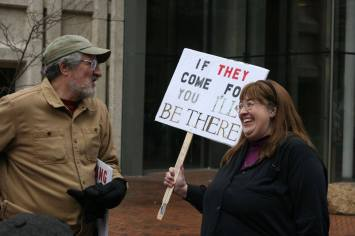 "A person holds a sign that says, ""if they come for you, I'll be there."""