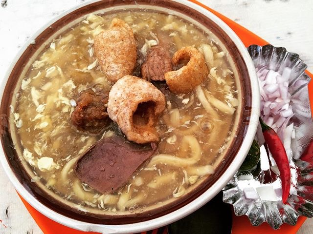 Lomi topped with chicharon