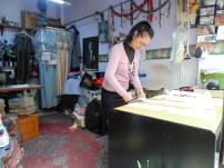 Local seamstress in her shop