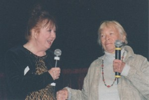FUN TV COUSINS-Betty Lynn and Mary Grace enjoy a moment onstage together at Judge Joel Laird's Mayberry Cast Reunion event in Pelham, Ala., in October 2000. Photo by Karen Leonard.