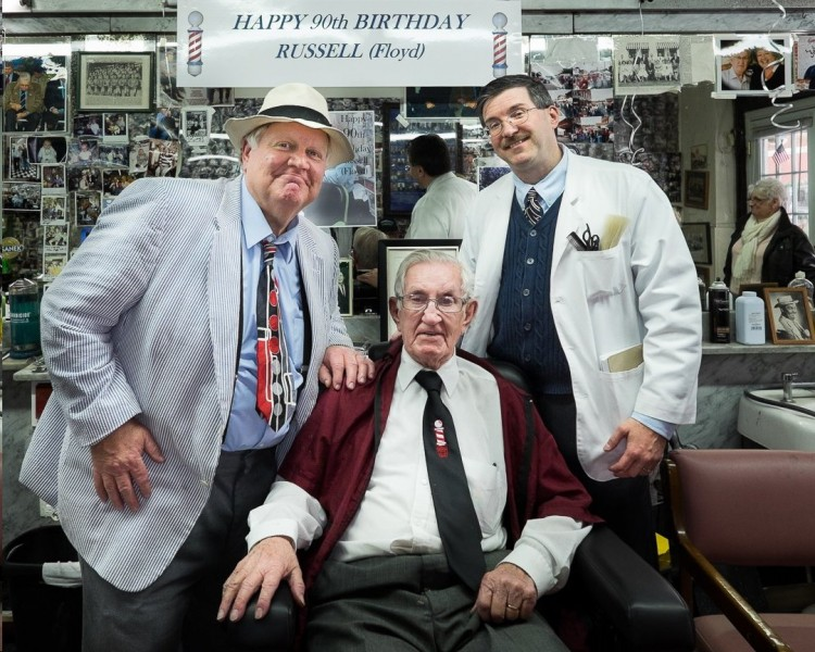 "Kenneth ""Otis"" Junkin  of ""Hearty Eatin' Men and Beautiful, Delicate Women"" chapter (Tuscaloosa, Ala.) and Allan Newsome of Mother Figure chapter (Huntsville, Ala.) help Russell Hiatt celebrate his 90th birthday in January.  Photo by Hobart Jones."
