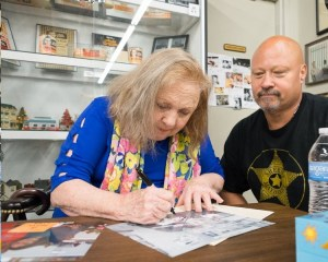 Betty Lynn signs a photo for TAGSRWC member Bruce Fisher at the Andy Griffith Museum in July. Photo by Hobart Jones.
