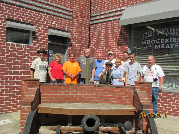 "GUARDING THE CANNON--Members of ""Only One Word I Think Of...Big!"" chapter (Mint Hill, N.C.) gathered at Mayberry Days for their annual group photo.  Word is that co-founder Tommy Rainwater (far left) scratched his initials (TR) in the side of the cannon.  Photo courtesy of Myron Clark."