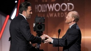 """HAPPY HAND-OFF--Ron Howard presents Ben Affleck the Hollywood Film Award for """"Gone Girl"""" at last Friday's Hollywood Film Awards...in Hollywood."""