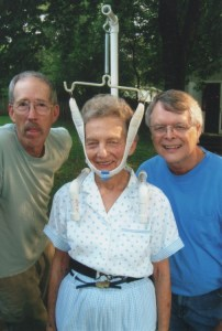 Shelton and Mike Johnson with Nancy Clark, their guinea pig for their latest contraption for the Barney chapter's entry in the Mayberry HEADED INTO THE STRETCH--Days parade in 2003. Photo by Kim Johnson.