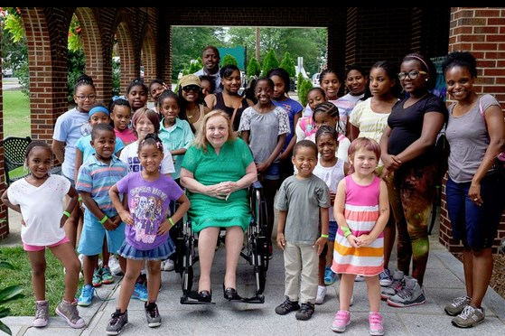 Betty goes green for a group of school kids visiting the Andy Griffith Museum in July.  Photo by Hobart Jones.