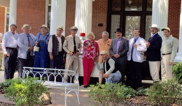 PILLARS OF MAYBERRY--Maggie Peterson and Rodney Dillard pose by posts with the Mayberry tribute artists during their visit to Troy, N.C., for the DARE fundraiser in August.