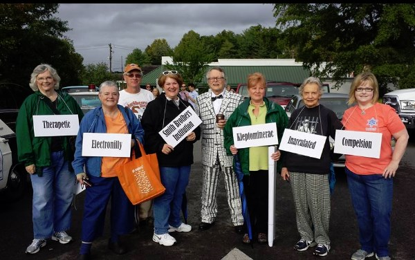 BEYOND WORDS--Members of Barney chapter (Greensboro, N.C.) lineup for the Mayberry Days parade. The nut in the middle is Mike Johnson in his salt- and-pepper suit made of many mini-packets of precisely alternating packets of salt and pepper.