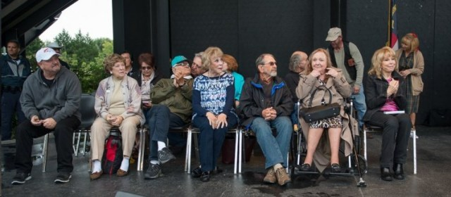 MAYBERRY ALL STARS--That's Ronnie Dapo at far left in the white cap, then Margaret Kerry, Ronnie Schell in the turquoise cap listening to Rodney Dillard, Maggie Peterson, Bruce Bilson, Clint Howard in profile, a wistful Betty Lynn and Barbara Eden. Photo by Hobart Jones.
