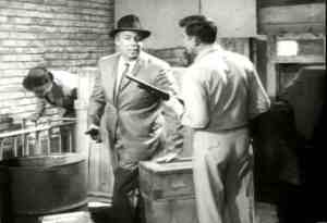 """STAKE OUT TIME-- George Kennedy in """"The Big House."""""""