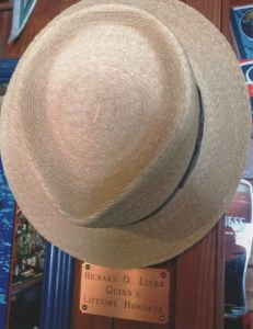 "A PLACE TO HANG HIS HAT--Dick had a designated spot for his hat (marked by a brass plaque, no less!) at his favorite retirement hangout, Quinns Almost by the Sea in Kailua-Kona. Like Norm on ""Cheers,"" he also had special seat that regulars always knew to keep available for Dick."