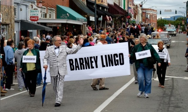 """YOU TOOK THE WORDS RIGHT OUT MY MOUTH""--More than just the plackets are packets, Mike Johnson in his actual salt-and-pepper suit leads the Barney chapter in the 2015 Mayberry Days parade. Photo by Hobart Jones."