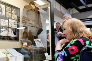 MAKING HER CASE--An obviously moved Betty Lynn gets her first look at the exhibit about her life that was unveiled just moments before. Photo by Jan Newsome.