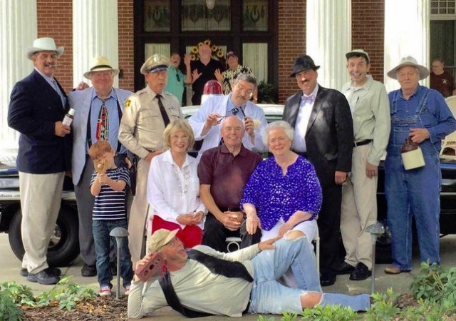 Maggie Peterson (seated, left) with some the of the Mayberry tribute artists, the VW Boys (in back), and other supporters of Mayberry Night in Troy, N.C., an event organized by Jeff Branch (seen here in the dark fedora as Howard Sprague tributer) that supports local DARE programs.