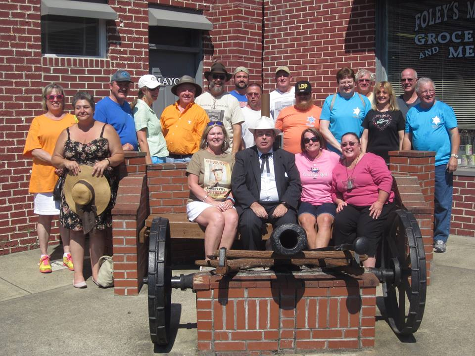 "BLOOEY--Members of ""Only One Word I Can Think of...Big"" (Mint Hill, N.C.) pose by a local cannon for their annual Mayberry Days group picture."