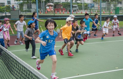 Junior Tennis Camp with children running by TAG International Tennis Academy