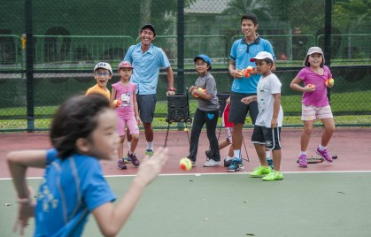 Junior Tennis Camp with children enjoying themselves by TAG International Tennis Academy