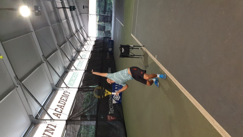 TAG International Tennis Academy's Coach Michael Mantua demonstrates a perfect platform Tennis Serve