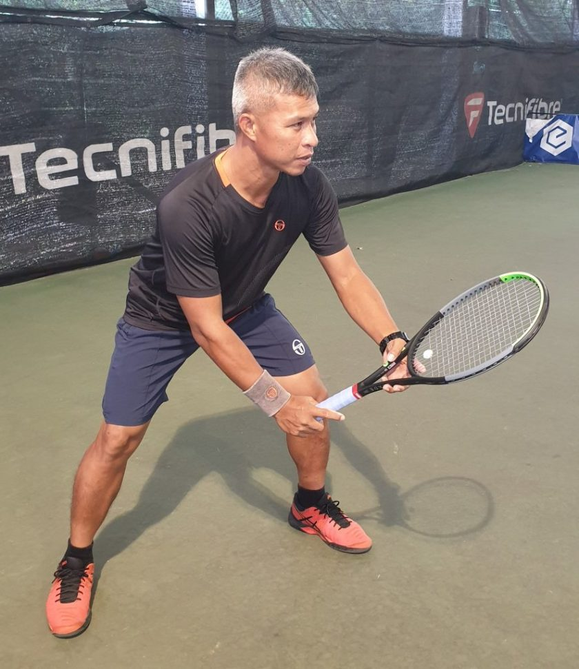 Close Up of TAG Coach Peter Return of Serve Grip