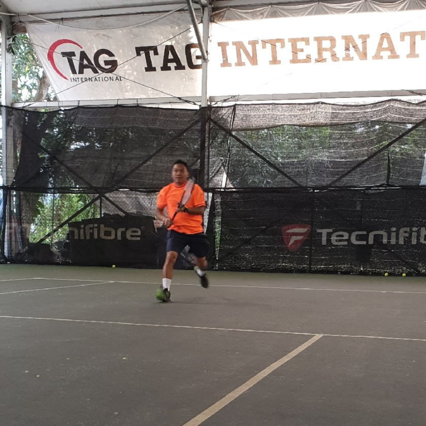 TAG Coach Ray follows the line of his serve when executing his serve and volley tactic