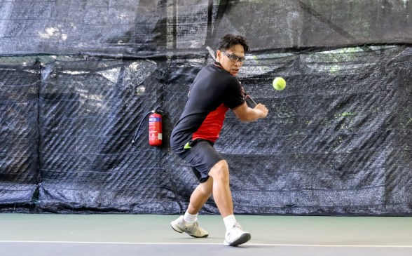 TAG Coach Bo Alburo gets ready to hit a one handed backhand