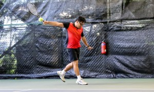 Coach Bo has a beautiful follow-through on his one handed backhand