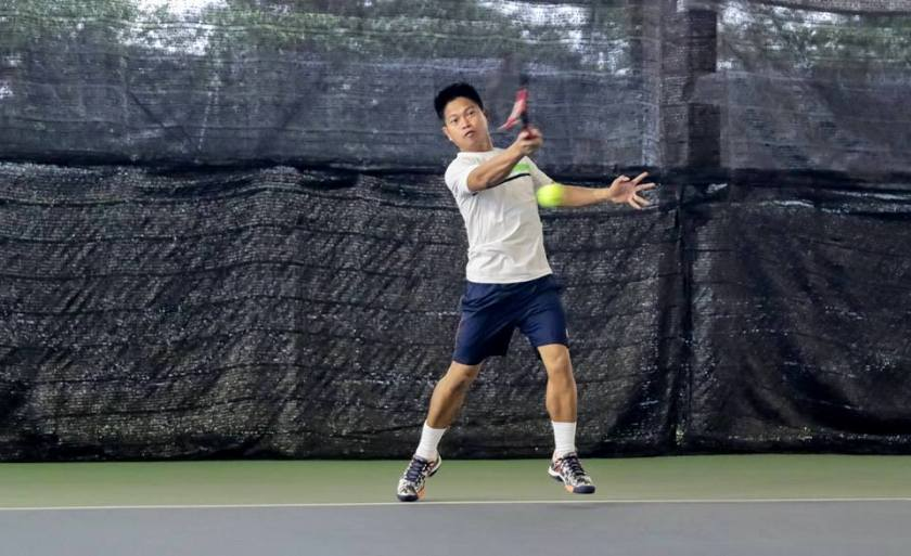 Coach Rocky Paglalunan of TAG International Tennis Academy with a semi-open stance on his forehand