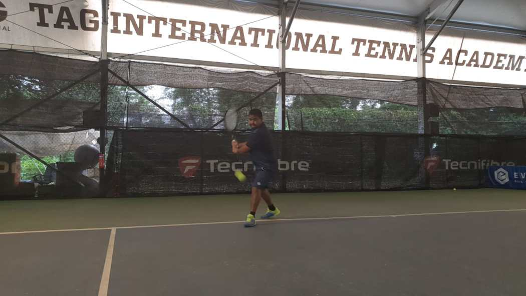 Coach Rapeepat Thonghatta sets up early for his backhand