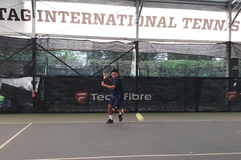 TAG Coach Dave Regencia prepares to hit a backhand slice with a good unit turn