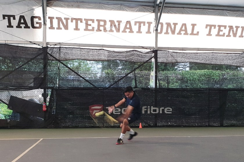 Coach Dave accelerates into the ball even on the backhand slice