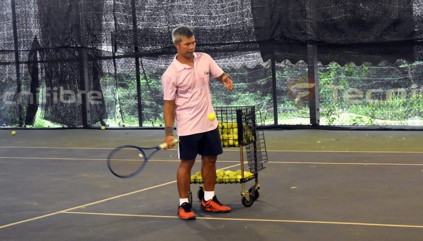 Coach Peter wearing ASICS Shoes during Private Tennis Lesson