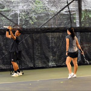 Coach Bo showing how to serve with Competitive Junior Tennis Player