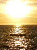 Sunset with a traditional fishing boat (perahu Philipine). From the harbor of Bahoi, Tagulandang